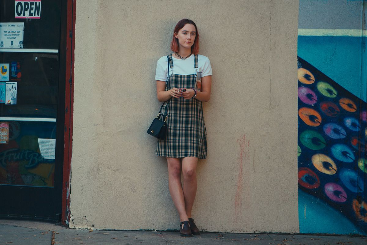 Saoirse Ronan standing against a wall in 'Ladybird'