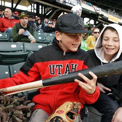 Dax Steadman, left, and Bryson Beals look over the broken bat given to them by a player during the Bees' 5-4 win.