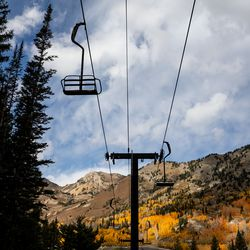 Alta's Albion lift is backdropped by fall foliage on Thursday, Oct. 7, 2021.