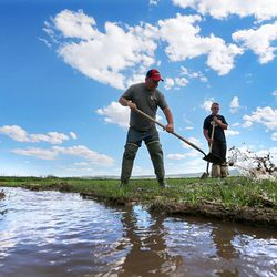 Wally Dodds and his son Makoy work their fields Monday, June 8, 2015, in Panguitch.