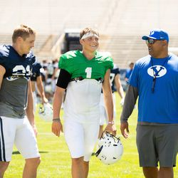 From left, BYU wide receiver Talon Shumway, quarterback Zach Wilson and coach Kalani Sitake talk while walking off the field during the Cougars' practice Wednesday, Aug. 21, 2019 at LaVell Edwards Stadium in Provo.