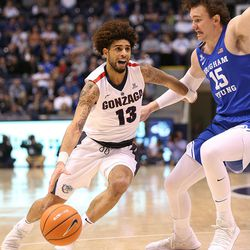 Gonzaga Bulldogs guard Josh Perkins (13) drives past Brigham Young Cougars forward Payton Dastrup (15) as BYU and Gonzaga play in an NCAA basketball game in the Marriott Center in Provo on Saturday, Feb. 24, 2018. Gonzaga won 79-65.