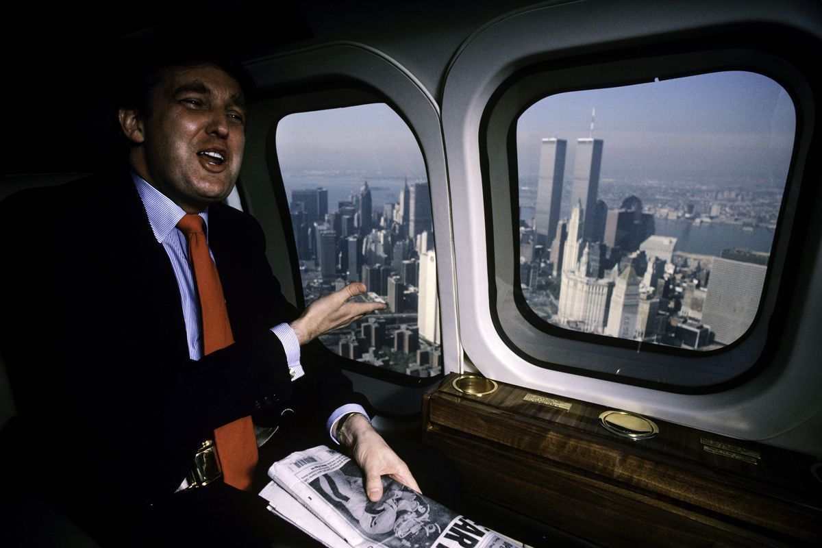 Donald Trump looks out of a helicopter.