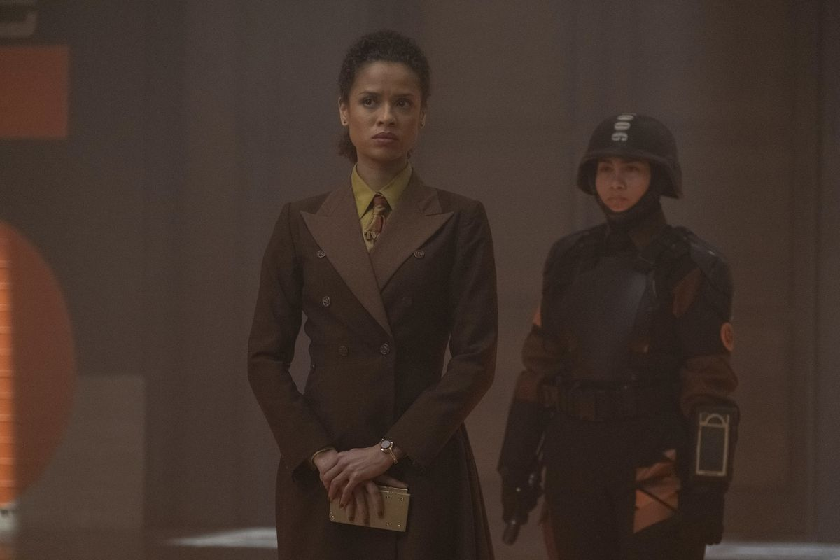 Judge Ravonna Renslayer (Gugu Mbatha-Raw) looks concerned as a TVA soldier stands behind her on Disney Plus' Loki