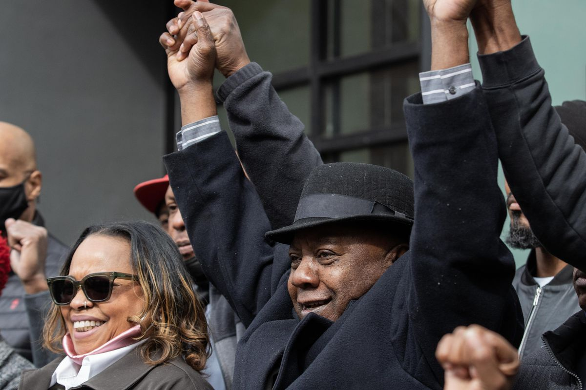 Former state Sen. Rickey Hendon holds hands with cannabis equity advocates outside Nature's Care West Loop in the West Town neighborhood on Tuesday morning, March 16, 2021.