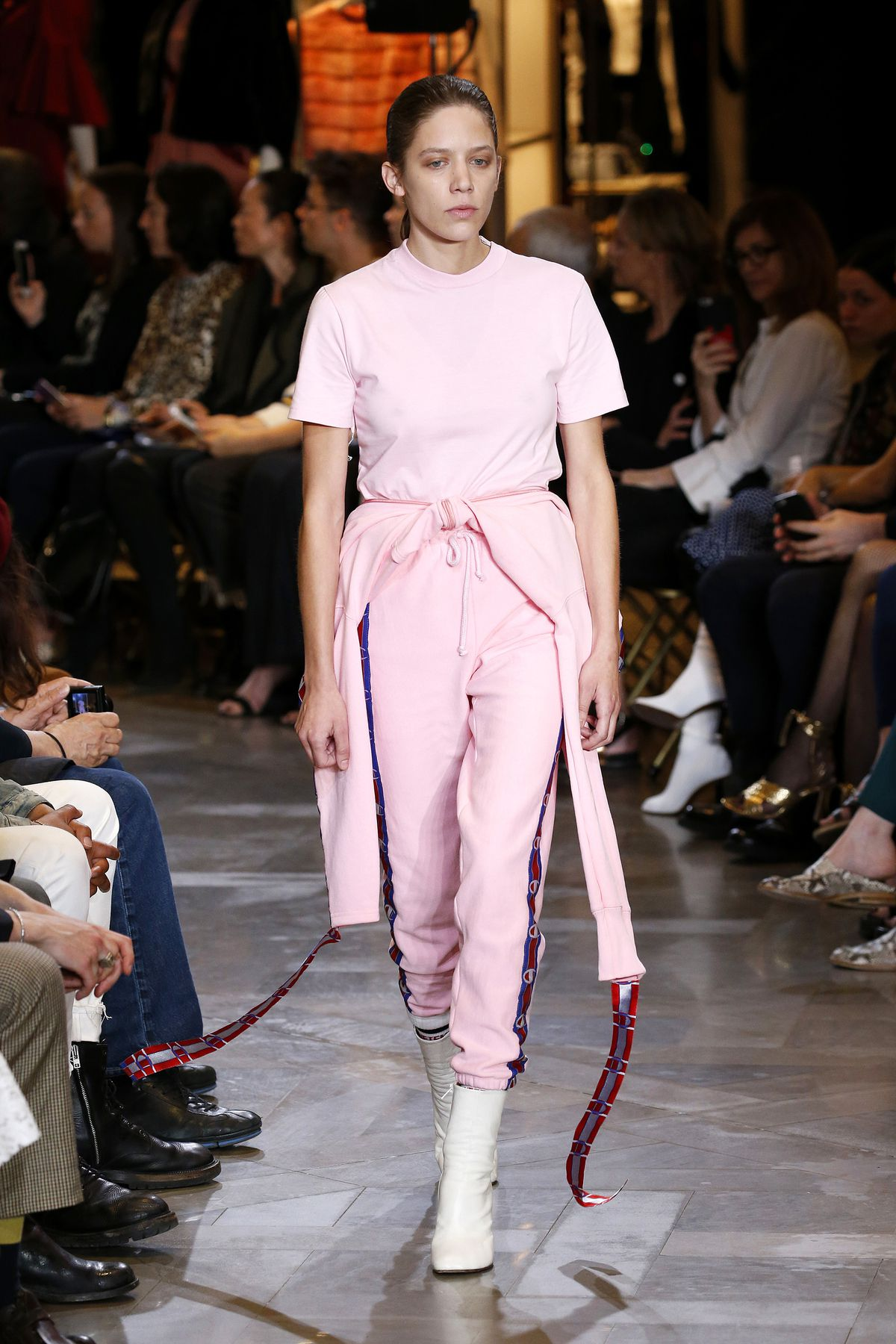 Model wearing pink Vetements x Champion outfit on the runway