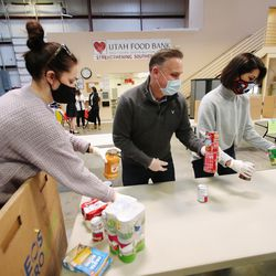 Lt. Gov.-elect Deidre Henderson, right, is joined by her husband, Gabe, center, and other members of their family in volunteering at the Utah Food Bank in St. George on Saturday, Jan. 2, 2021.