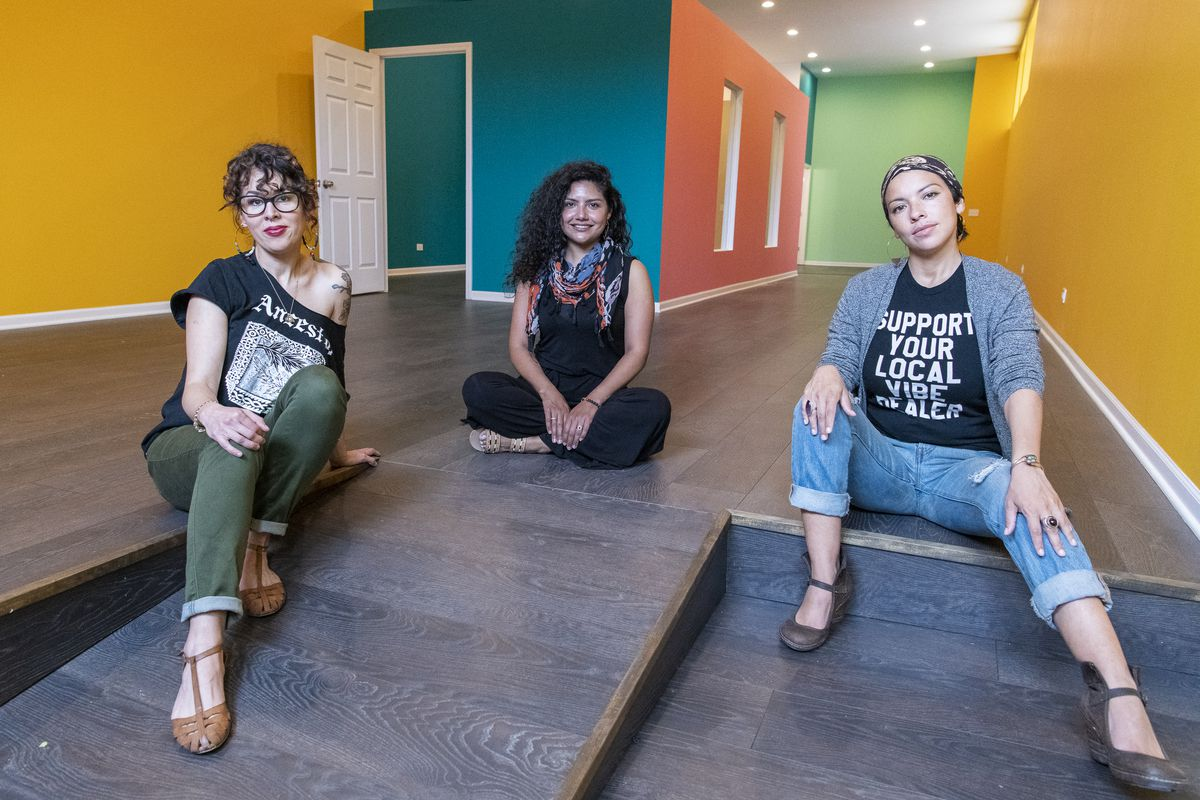 Denise S. Ruiz (from left), Dorian A. Ortega, and Cristina Gutierrez, sit together inside their new creative co-working space in Humboldt Park, the Honeycomb Network. They hope to open in June or July, Thursday.