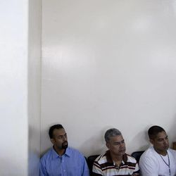 In this Aug. 20, 2012 photo, U.S. citizen Jason Sachary Puracal, left, sits next to other detainees during his appeals hearing in Granada, Nicaragua. As a three-judge appellate panel mulls the 35-year-old American's fate, the case has drawn the scrutiny of U.S. lawmakers and human-rights advocates, including the California Innocence Project, which works to absolve people who have been wrongfully convicted. In late 2010 masked policemen raided his seafront real estate office and took him to Nicaragua's maximum security prison. Prosecutors charged that Puracal was using his business as a front for money laundering in a region used to transport cocaine from Colombia to the United States. Because no drugs or cash were seized, Puracal's family and friends thought he wouldn't be held long, but nine months later, a judge convicted Puracal and sentenced him to 22 years in prison.