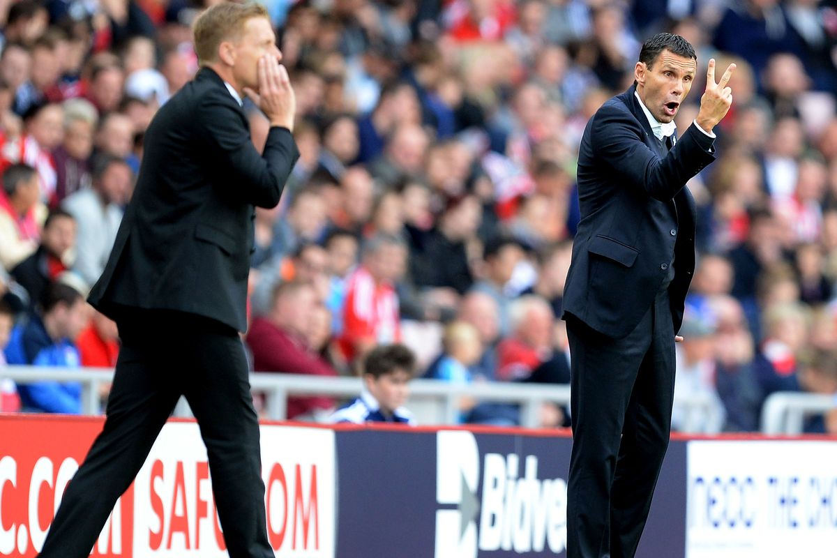 Gus Poyet and Garry Monk during the 0-0 draw earlier this season.