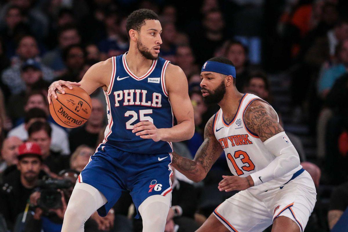 Philadelphia 76ers guard Ben Simmons dribbles as New York Knicks forward Marcus Morris Sr. defends during the first half at Madison Square Garden.