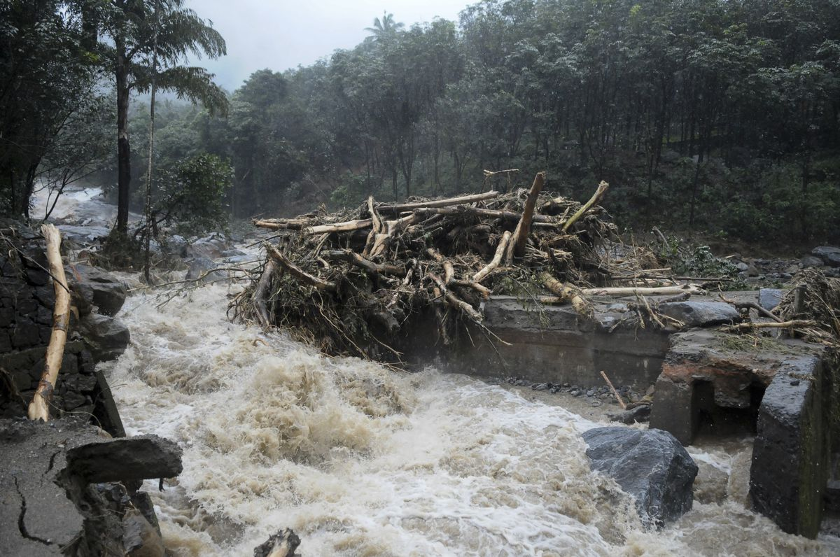 Water gushes out following heavy rain and landslides in Kozhikode, Kerala, on August 9, 2018.