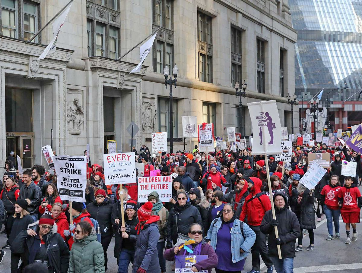Striking Chicago Teachers Union members march outside City Hall in 2019.