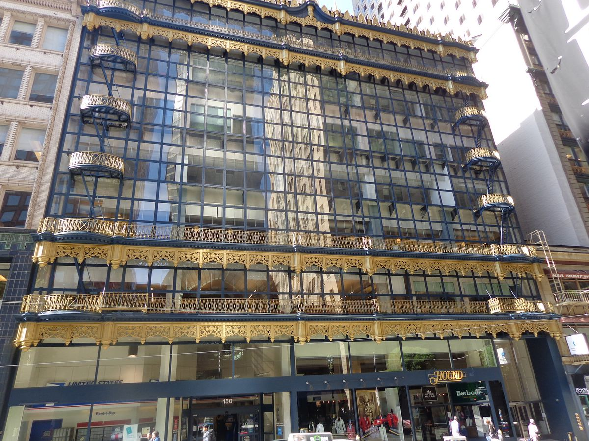The exterior of the Hallidie Building. The facade has many windows.