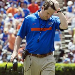 Florida coach Will Muschamp pushes his hair back during the Orange and Blue NCAA college football game in Gainesville, Fla., Saturday, April 7, 2012.