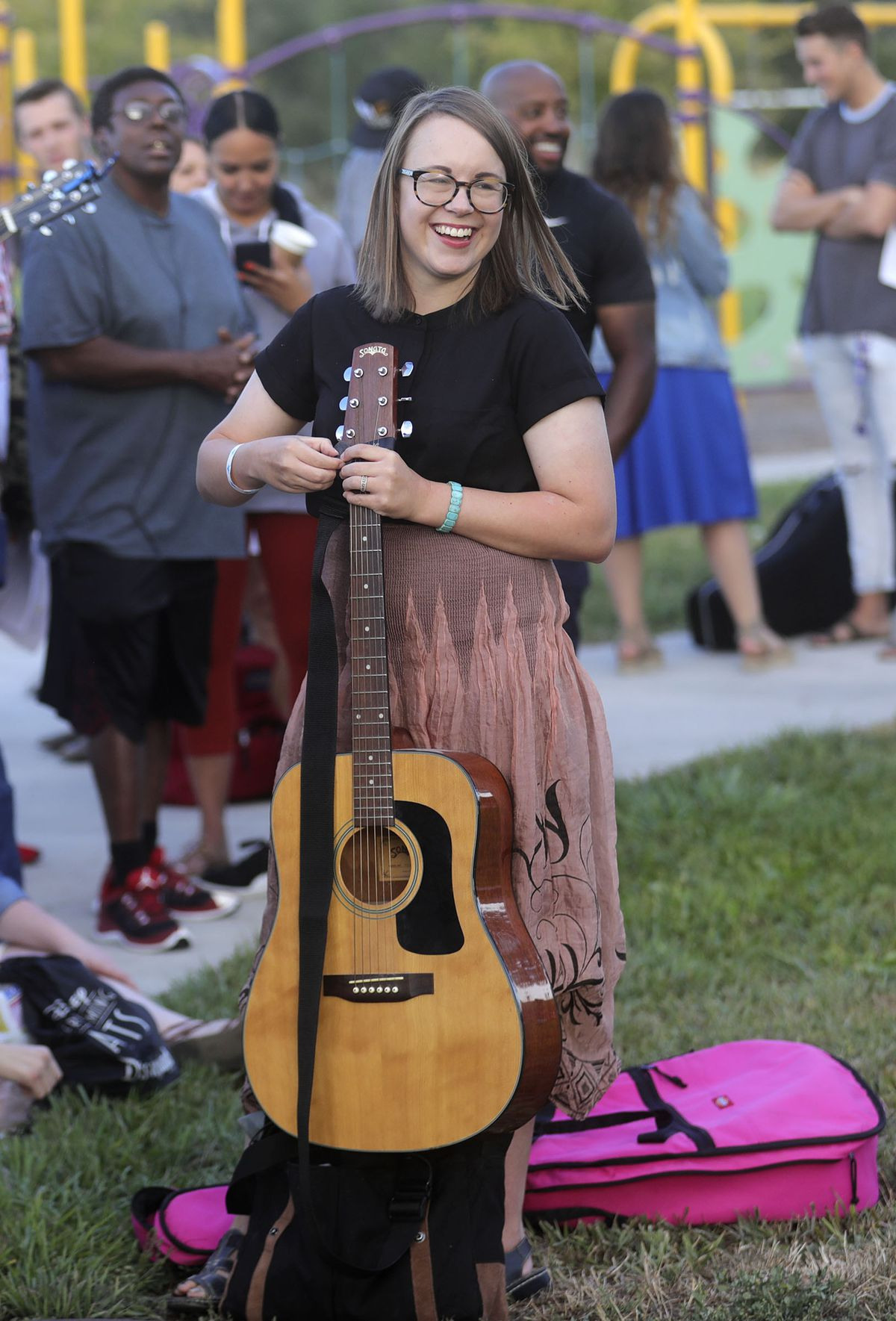 Lottie Johnson, Deseret News arts and entertainment assistant editor, picks up her guitar while waiting for American Idol auditions outside of the Northwest Community Center in Salt Lake City on Thursday, Aug. 29, 2019.