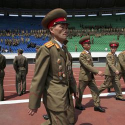 Military members attend a mass meeting of North Korea's ruling party at a stadium in Pyongyang, North Korea, on Saturday, April 14, 2012. North Korea will mark the 100-year birth anniversary of the late leader Kim Il Sung on Sunday April 15.