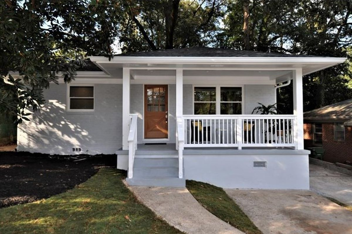 One-story white house with covered front porch.