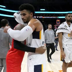 Rio Grande Valley Vipers' Monte Morris (No. 11) and Salt Lake City Stars' Naz Mitrou-Long (No. 3), who were former Iowa State teammates, hug after playing in an NBA G league basketball game at the Vivint Smart Home Arena in Salt Lake City on Monday, Nov. 27, 2017.