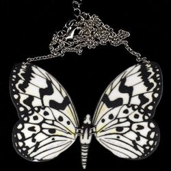 """""""Drawn from nature, the <a href=""""http://birdqueendesigns.com/artwork/2654117_Rice_Paper_Butterfly.html"""">Rice Paper Butterfly Necklace</a> ($36) has a design that's both striking and bold, with a high-contrast print."""""""