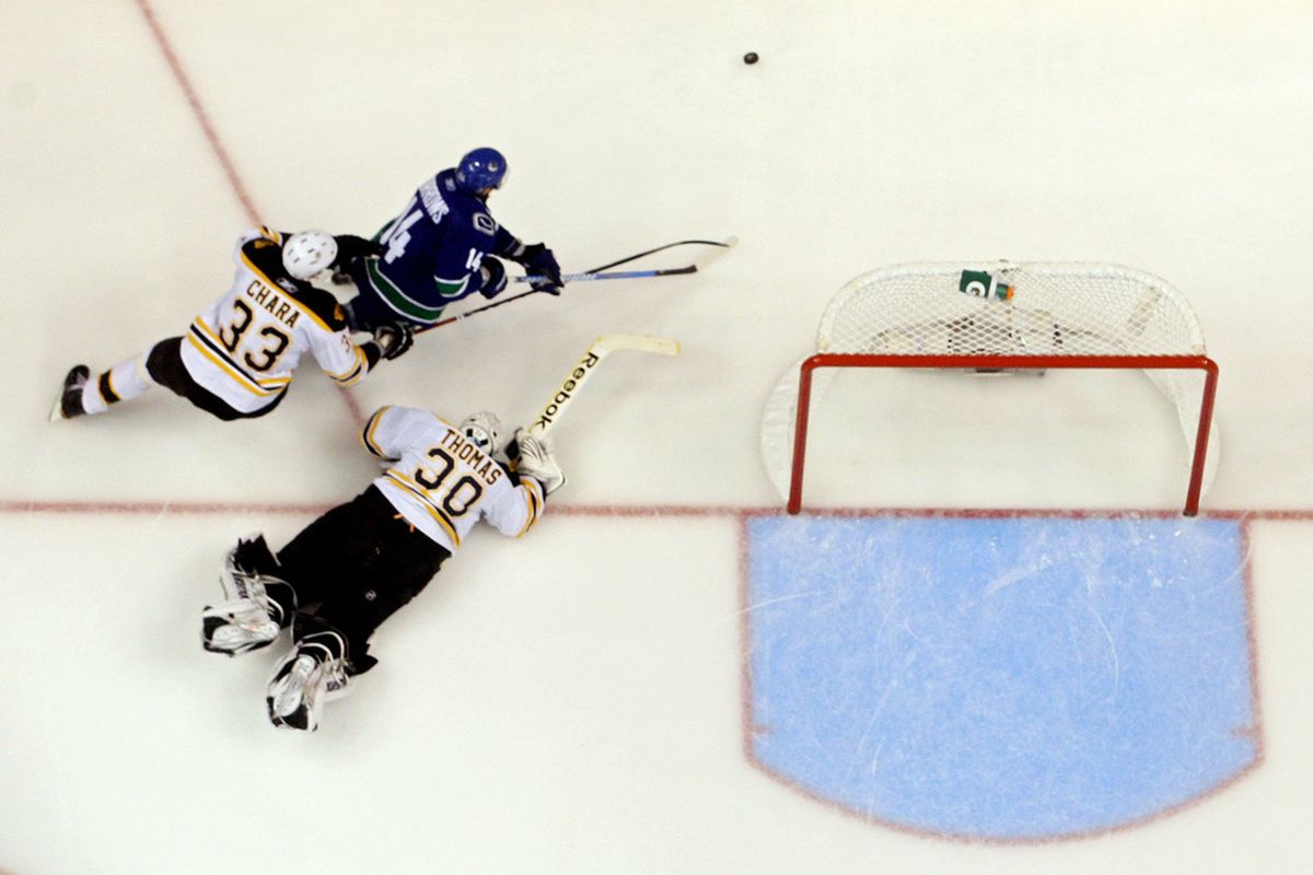 At this point, Tim Thomas realized he had made a colossal error in when to attack the shooter, mostly because he was way the hell away from the goal. Whiff. (Photo by Bruce Bennett/Getty Images)