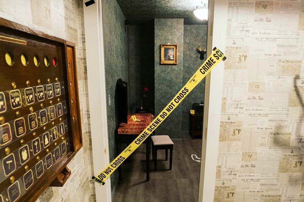 Interior of an escape room designed as a crime scene, where players solve clues and puzzles to win the game and be let out of the room early.