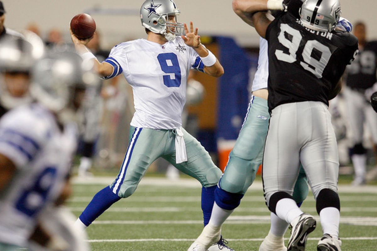ARLINGTON TX - AUGUST 12:  Tony Romo #9 looks to pass the ball during the preseason game against the Oakland Raiders at Dallas Cowboys Stadium on August 12 2010 in Arlington Texas.  (Photo by Tom Pennington/Getty Images)