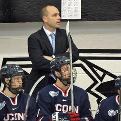 UConn head coach Mike Cavanaugh follows the action on the ice.