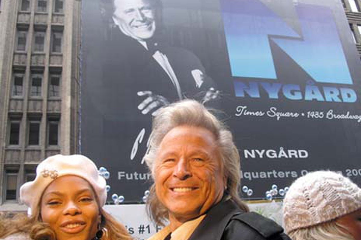 """Peter Nygård in front of a poster of Peter Nygård.  Image via <a href=""""http://www2.nygard.com/Store/webcast/NY_event_Macy%27s_parade/page2.asp#"""">Nygård</a>. Nygård!"""