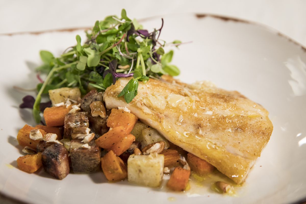 Wild Striped Bass and Roasted Root Vegetables.   Ashlee Rezin/Sun-Times
