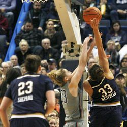 UConn's Katie Lou Samuelson (33) tries to block the shot of Notre Dame's Kathryn Westbeld (33) during the Notre Dame Fighting Irish vs UConn Huskies women's college basketball game in the Women's Jimmy V Classic at the XL Center in Hartford, CT on December 3, 2017.