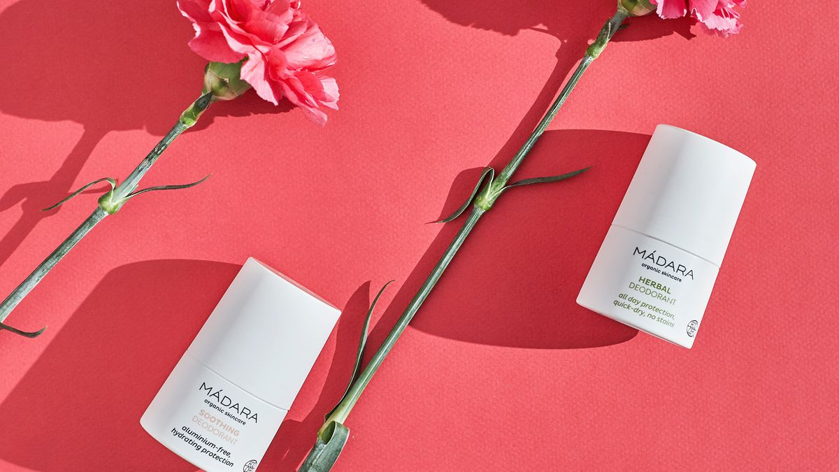 Beaut products with flowers on a pink background
