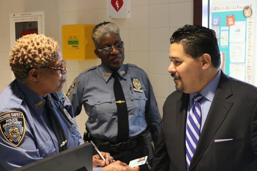 Schools Chancellor Richard Carranza chats with school safety agents on Staten Island.