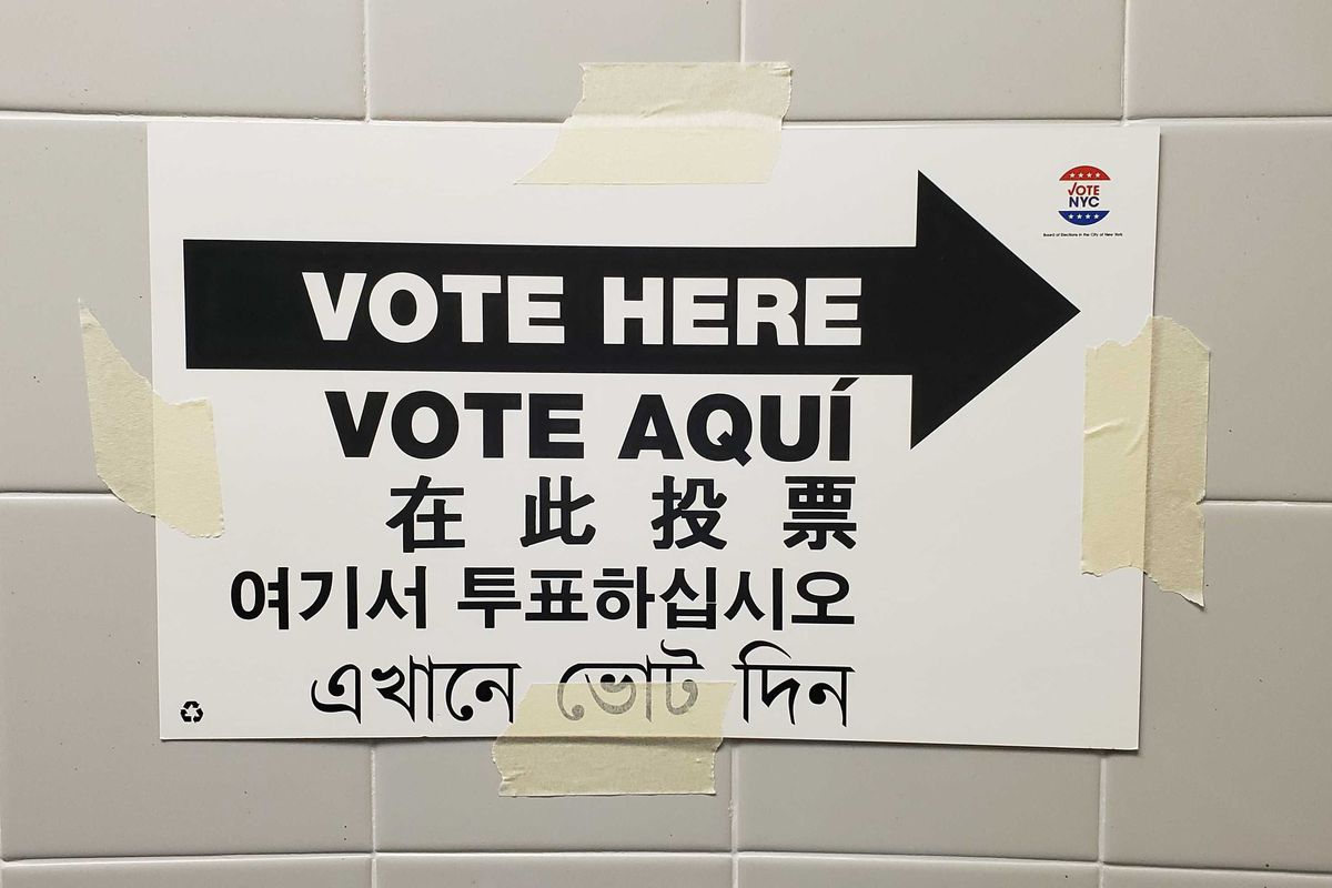 A sign directs voters toward the polling site at PS 70 in Astoria, Queens.