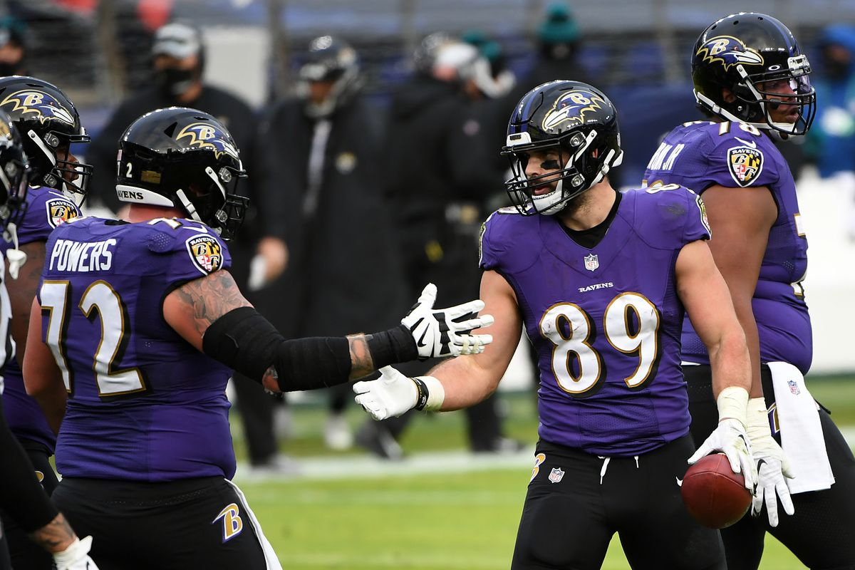 Tight end Mark Andrews #89 of the Baltimore Ravens celebrates with teammate guard Ben Powers #72 following a touchdown reception during the fourth quarter of their game against the Jacksonville Jaguars at M&T Bank Stadium on December 20, 2020 in Baltimore, Maryland.