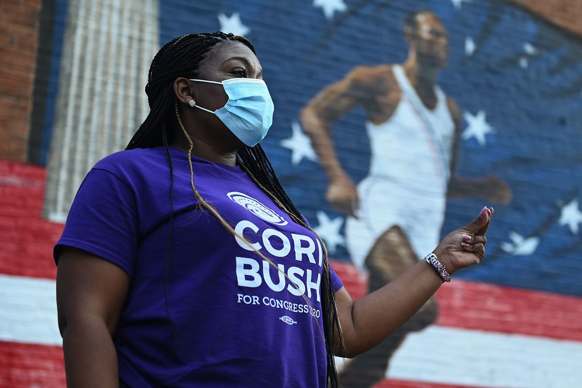 Cori Bush (D-MO) speaks to supporters during a canvassing event in August.