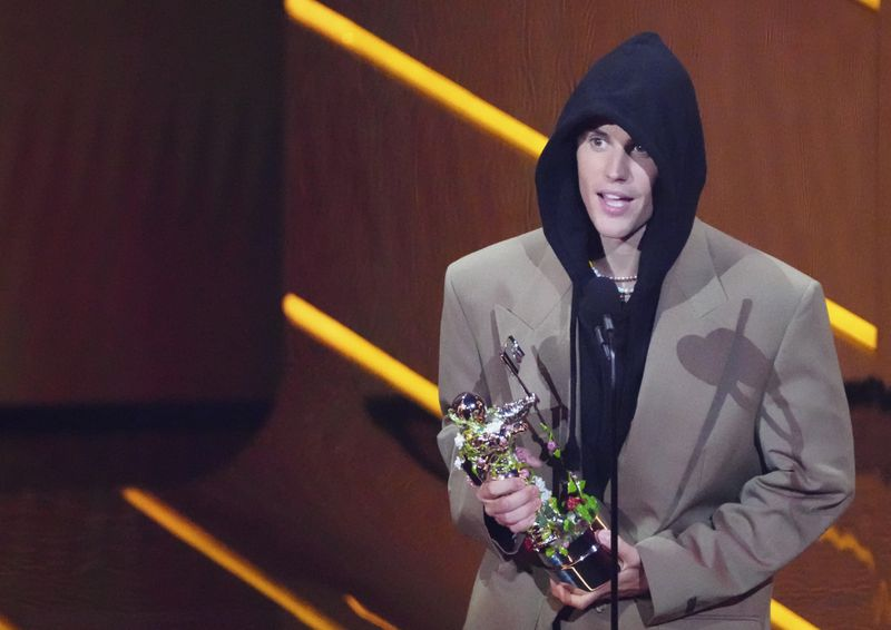 Justin Bieber accepts the award for artist of the year at the MTV Video Music Awards at Barclays Center on Sunday night in New York.