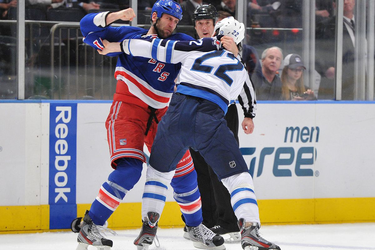 NEW YORK, NY - JANUARY 24: Mike Rupp #71 of the New York Rangers and Chris Thorburn #22 of the Winnipeg Jets fight during the first period on January 24, 2012 at Madison Square Garden in New York City. (Photo by Christopher Pasatieri/Getty Images)