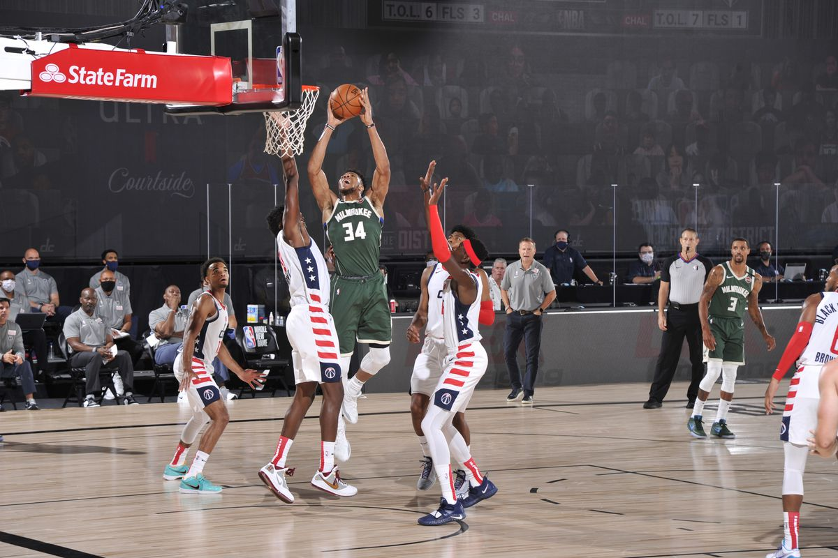 Giannis Antetokounmpo of the Milwaukee Bucks shoots the ball against the Washington Wizards on August 11, 2020 at Visa Athletic Center at ESPN Wide World of Sports in Orlando, Florida.