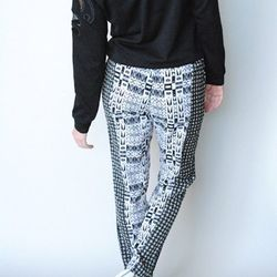 """<a href=""""http://www.shopvonz.com/collections/bottoms/products/black-white-printed-pants"""">Jealous Tomato Black and White Printed Pants</a>, $48"""