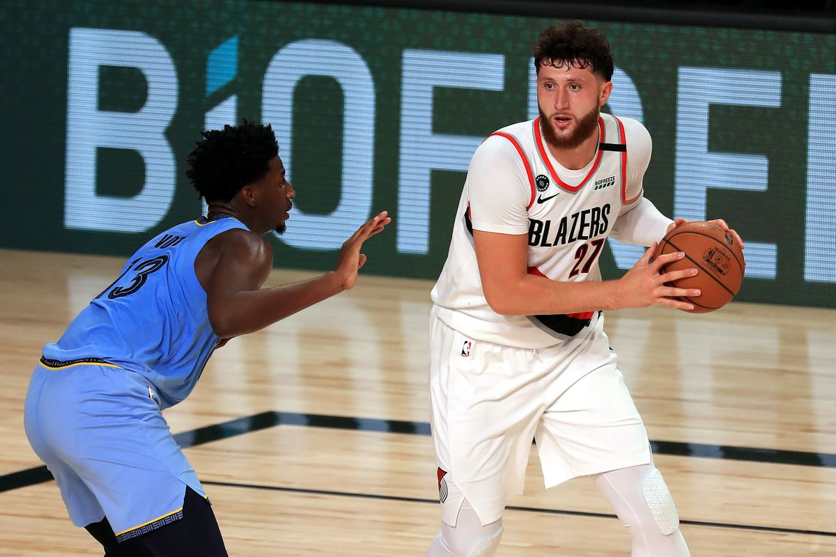 Jaren Jackson Jr. of the Memphis Grizzlies defends Jusuf Nurkic of the Portland Trail Blazers during the second half at The Arena at ESPN Wide World Of Sports Complex on July 31, 2020 in Lake Buena Vista, Florida.
