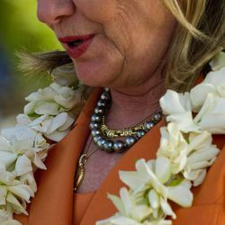 U.S. Secretary of State Hillary Rodham Clinton wears her black pearl necklace, a gift from Cook Island Prime Minister Henry Puna, during an event on sustainable development and conservation, in Rarotonga, Cook Islands, Friday, Aug. 31, 2012.
