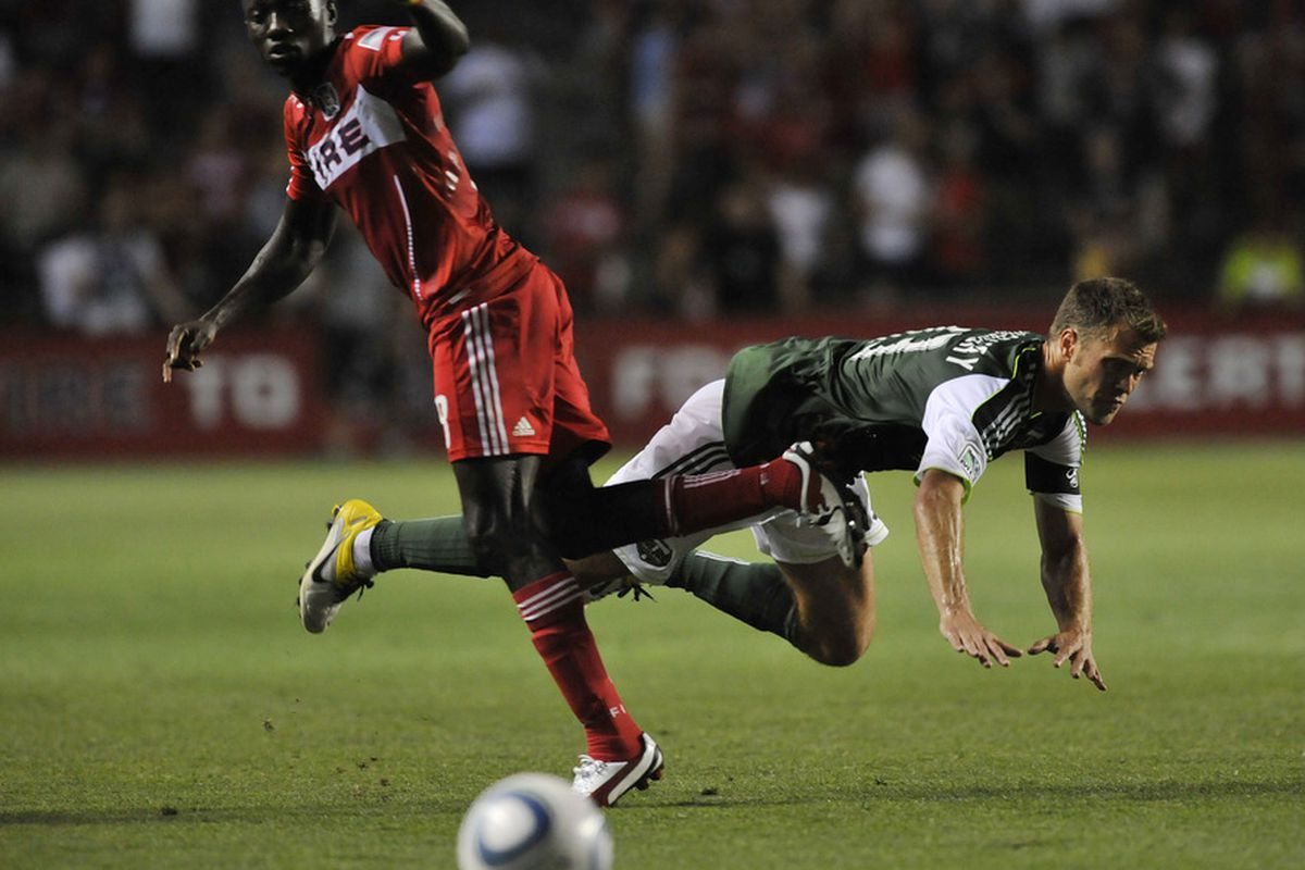 BRIDGEVIEW, IL - JULY 16: Patrick Nyarko #8 of the Chicago Fire is defended by Jack Jewsbury #13 of the Portland Timbers during an MLS match on July 16, 2011 at Toyota Park in Bridgeview, Illinois. (Photo by David Banks/Getty Images)