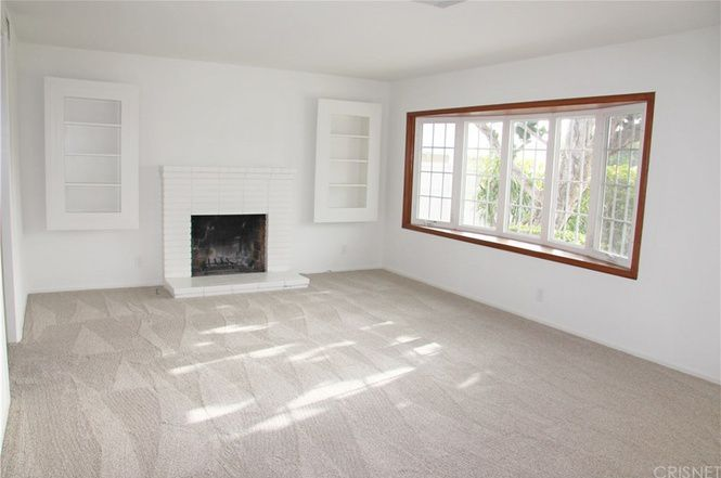 Living room with carpet and fireplace