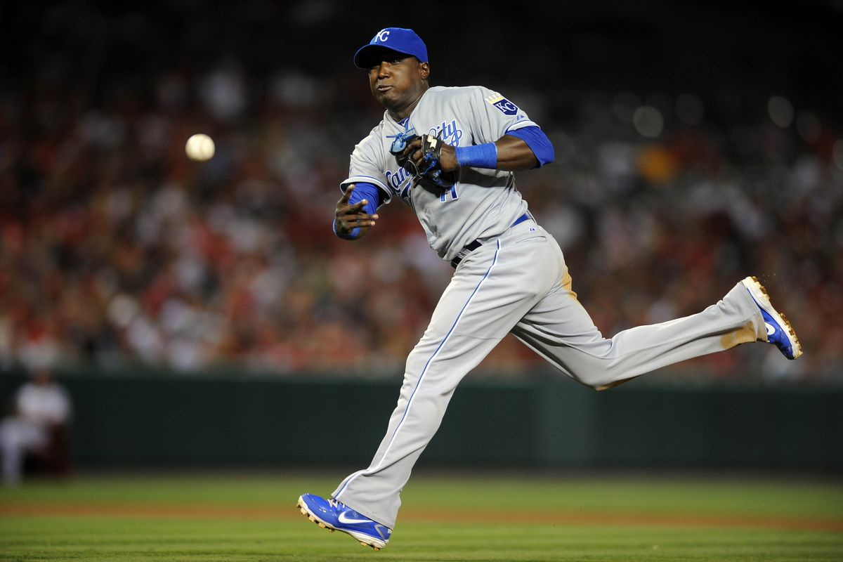 Jul 23, 2012; Anaheim, CA, USA; Kansas City Royals second baseman Yuniesky Betancourt (11) throws to first against the Los Angeles Angels during the fifth inning at Angel Stadium of Anaheim. Mandatory Credit: Kelvin Kuo-US PRESSWIRE