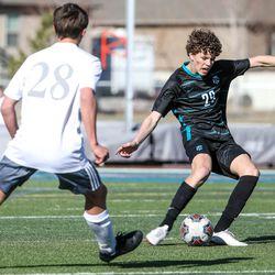 Farmington's Luke Smith (29) moves with the ball during the game against Olympus at Farmington High School on Thursday, March 18, 2021.