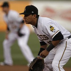 First baseman Efren Navarro fields as the Salt Lake Bees open the season at home  in Salt Lake City  Friday, April 13, 2012.