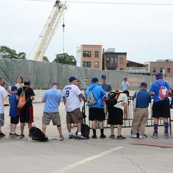 2:57 p.m. Fans waiting for autographs, on Waveland, in front of the VIP/Players' parking tent -