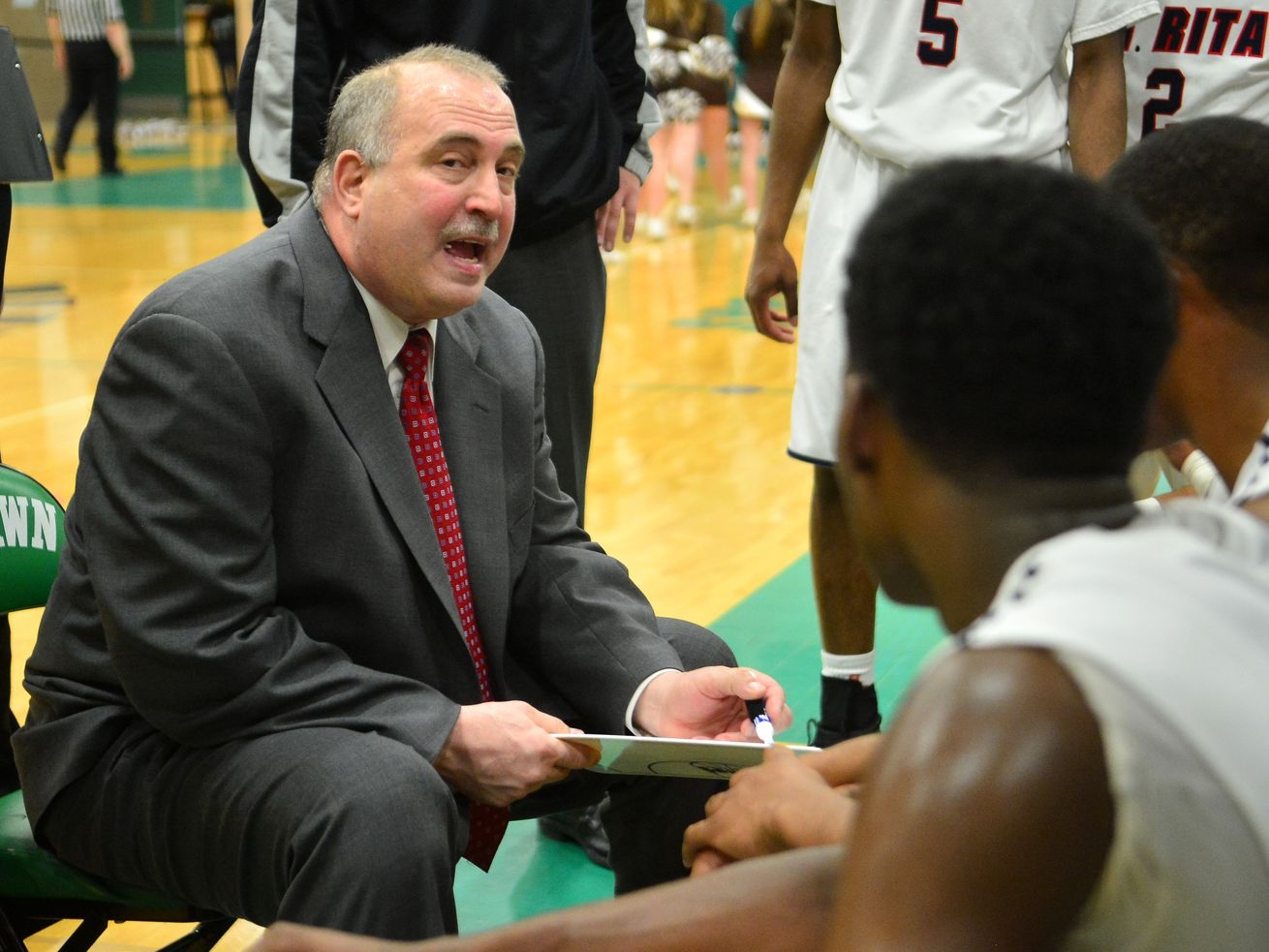Gary DeCesare, coaching St. Rita, talks strategy during a timeout in the game against Mount Carmel.