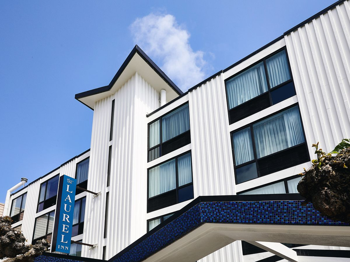 The exterior of the Laurel Inn in San Francisco. The facade is white with multiple windows.